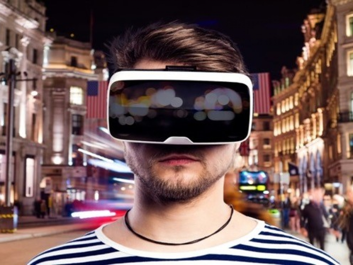 A person in a striped shirt wearing VR goggles