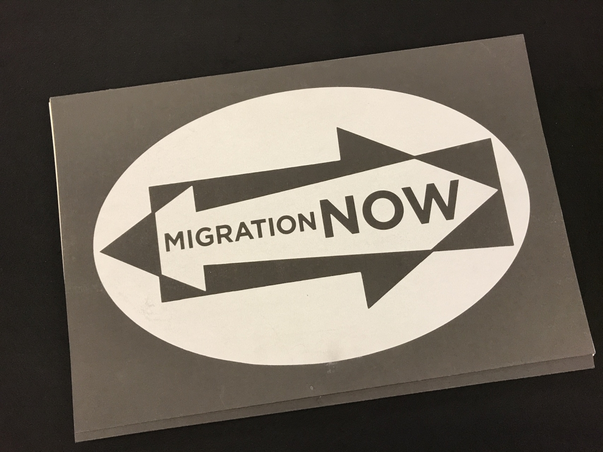 """An illustration of two arrows with the text """"Migration Now"""""""