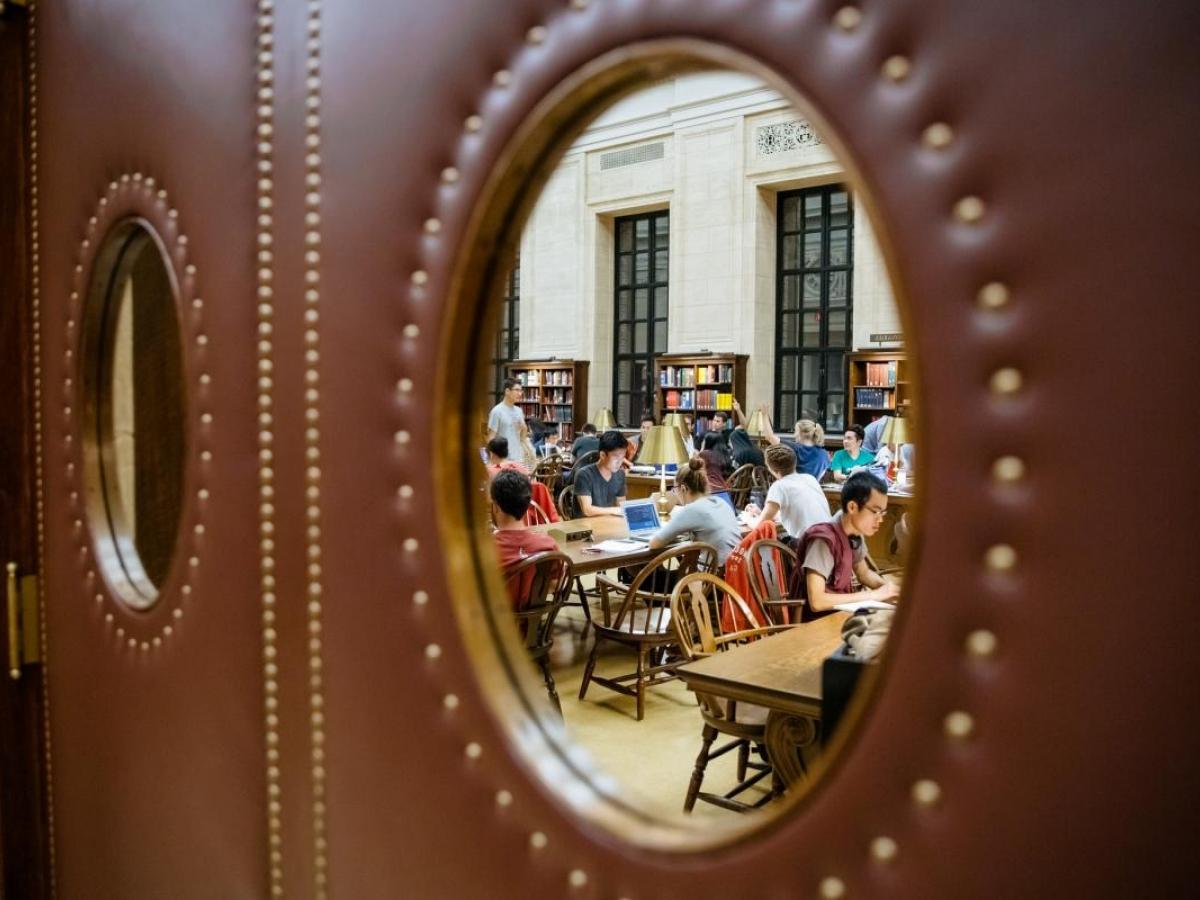 Image of students through a door window