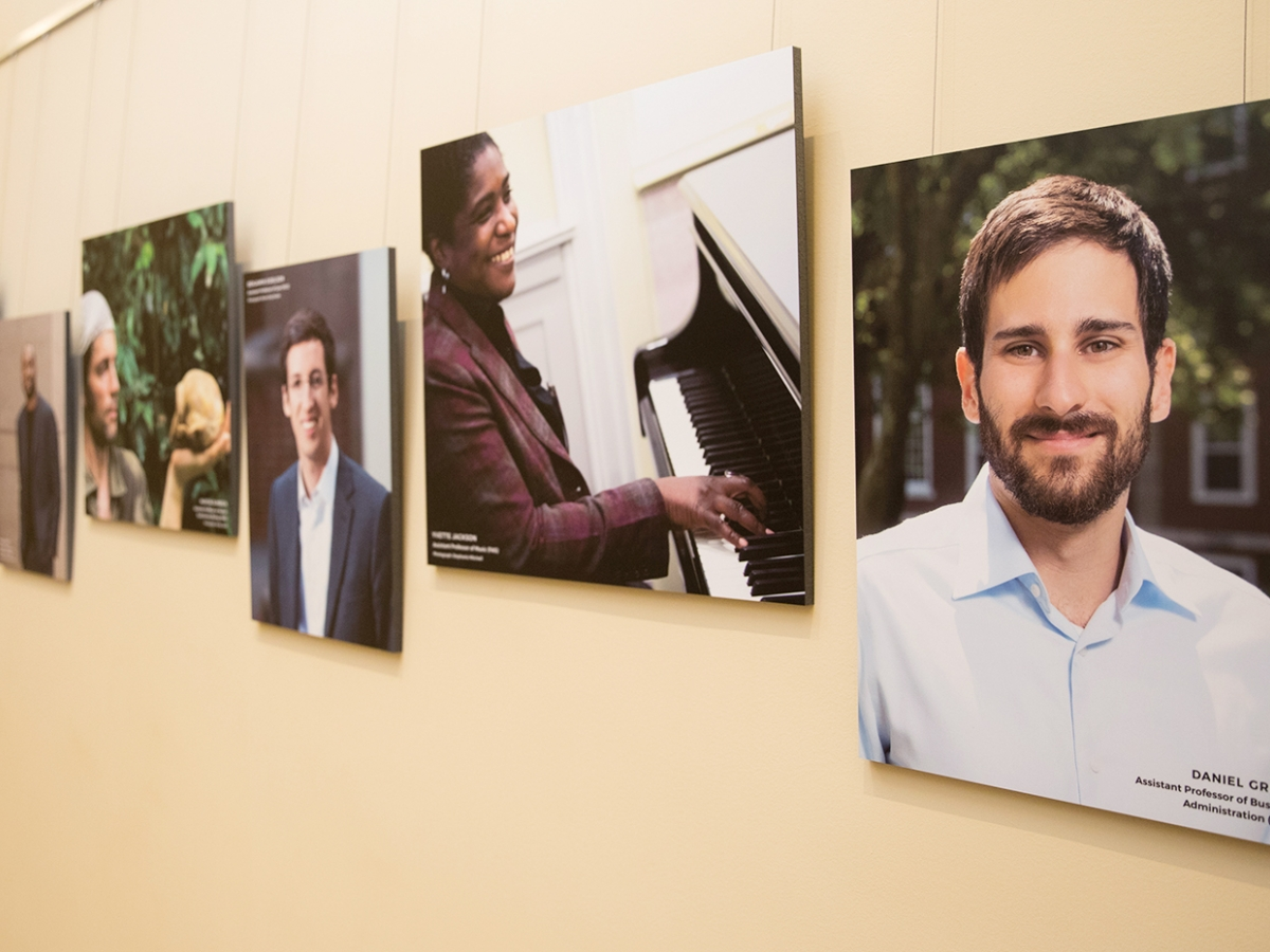 Portraits of faculty members hanging in the gallery