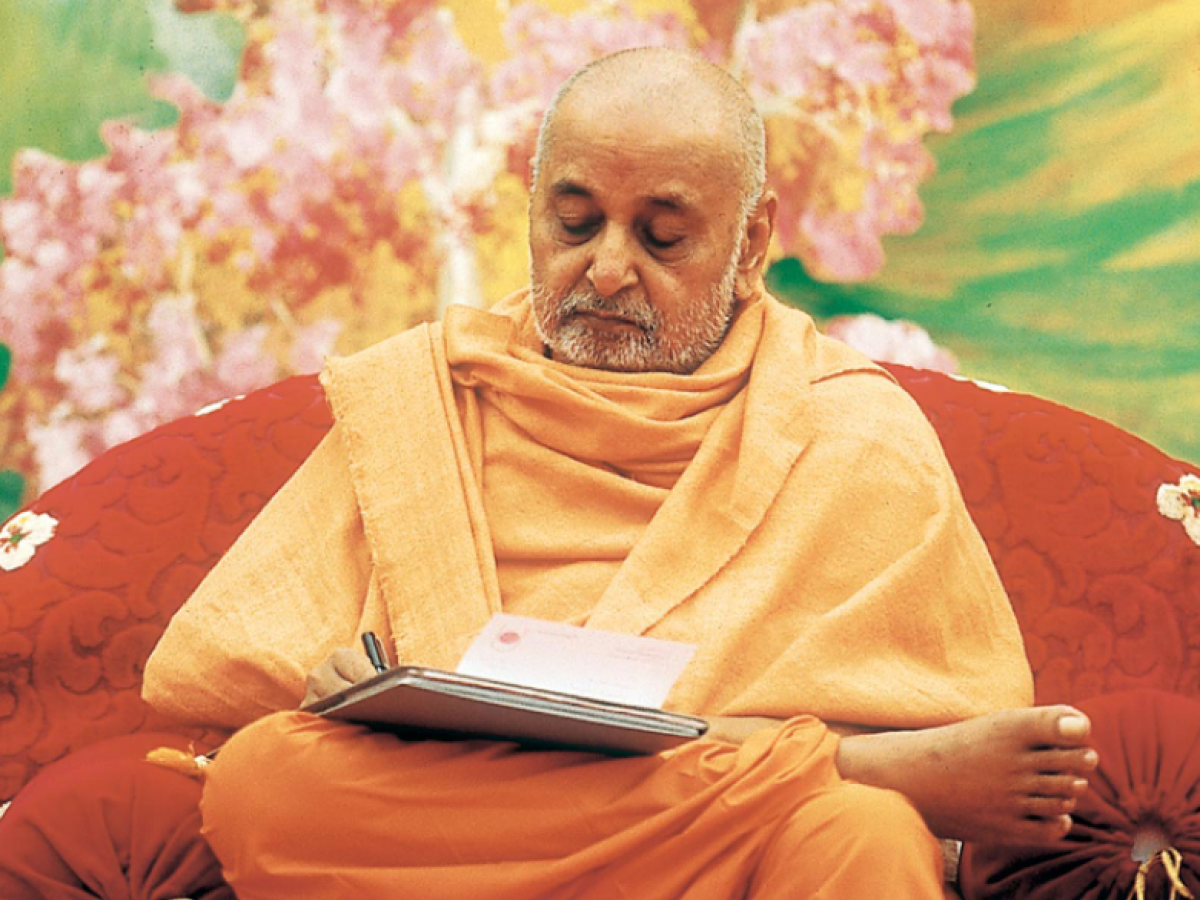 Photograph of a man in orange monk's robes