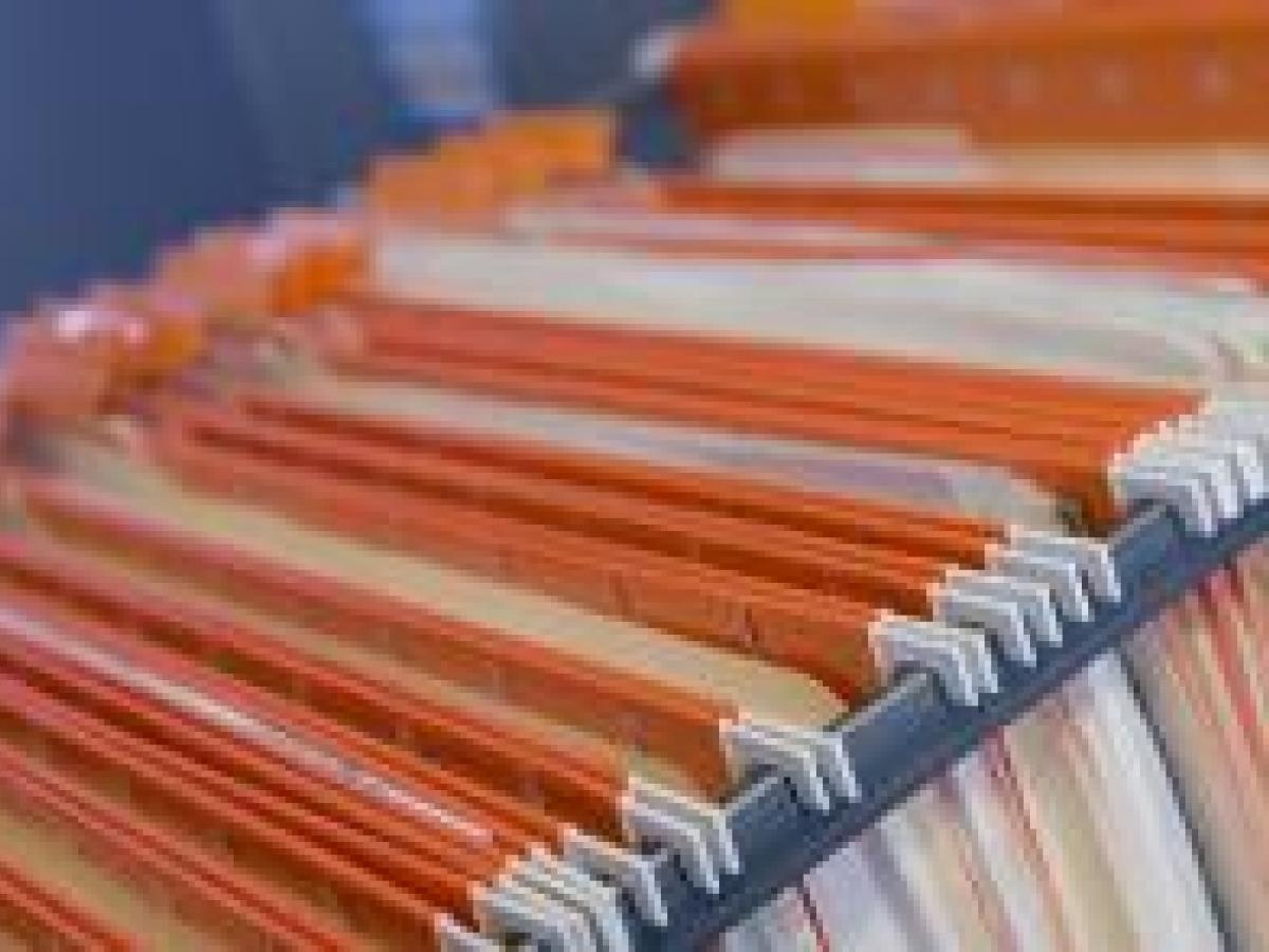 Orange file folders in a drawer