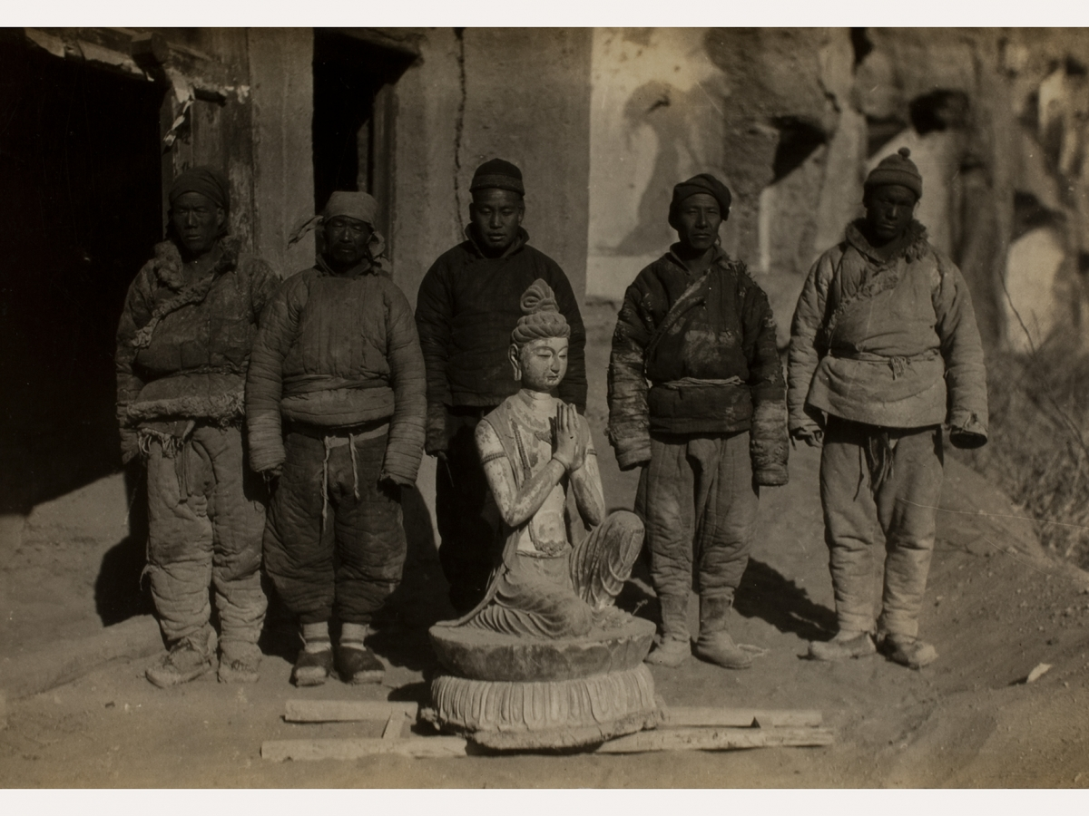 Removal of the Kneeling Attendant Bodhisattva statue.