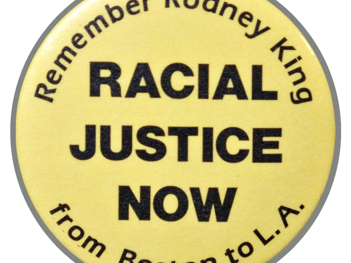 """Yellow button that reads """"Remember Rodney King. Racial justice now, from Boston to L.A."""