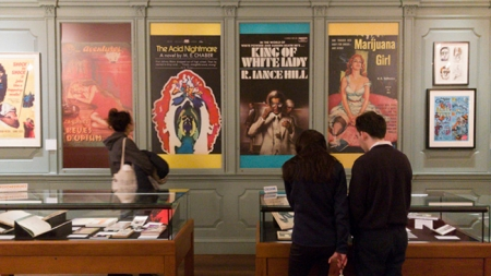 Visitors attend an exhibit at Houghton Library