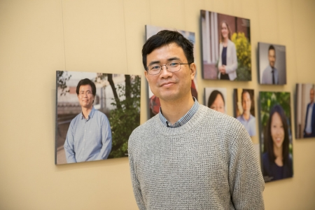 Junwei Lu, Assistant Professor of Biostatistics at the T.H. Chan School of Public Health, poses by his portrait.