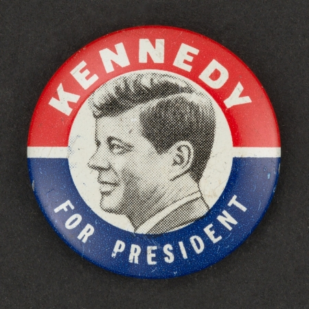"Political button with an image of JFK and the text ""Kennedy for President"""