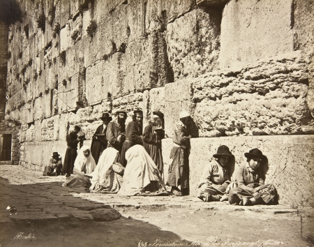People pray at the Western Wall, circa 1880.