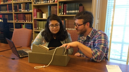 2017-2018 Visiting Fellow​ Dr. Ermine Algaier and his research assistant Diana J. Rhubi in Houghton Library's reading room.​