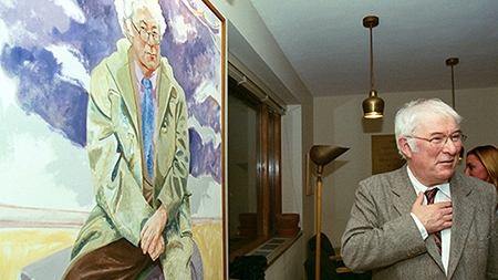 Seamus Heaney beside his portrait in the Poetry Room