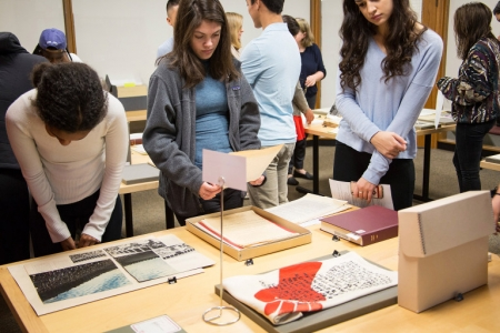 Students examine materials in the Archives as part of a class.