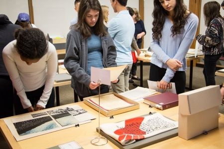 Students examine materials during a class at the Harvard University Archives