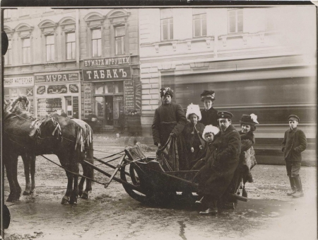 Poliksena Nesterovna Shishkina-Iavein in a horse-drawn sleigh with her children and husband on Nevskii Prospekt during Maslenitsa, 1909.​