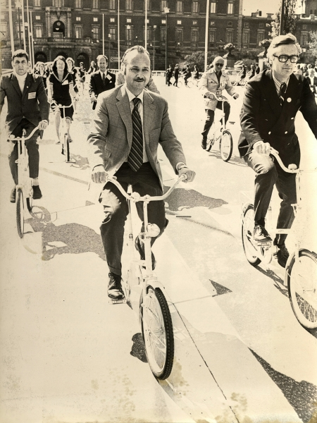 Maurice Strong, Jan Mårtenson, and Swedish Information Center staff use the bikeshare of the 1972 UN Conference on the Human Environment in Stockholm.