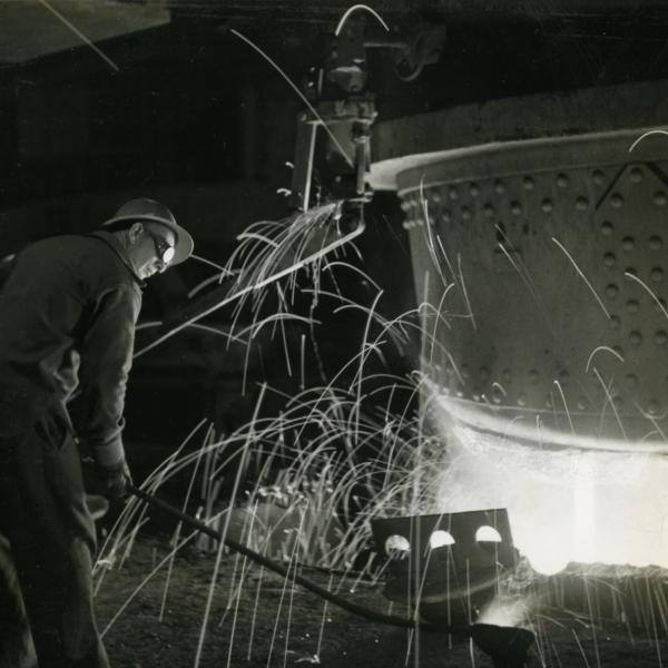 Taking a sample of steel for testing, Geneva Steel Plant