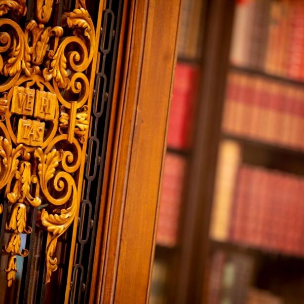 Close-up of 'Veritas' logo on a door in Widener Library