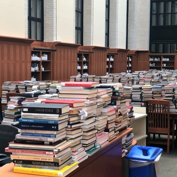 Stacks of books on tables