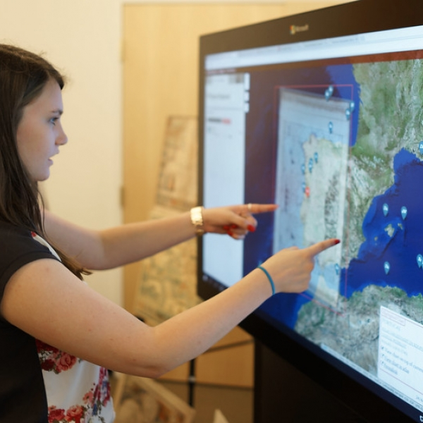A student explores data visualization on a screen at Lamont