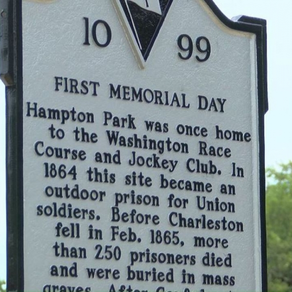 """A plaque reading """"First Memorial Day"""" and describing the history of the day"""