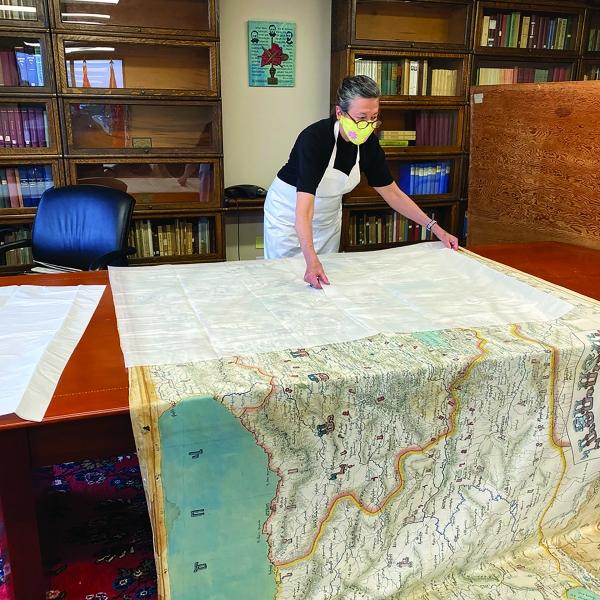 Louise Baptiste preparing the map for transport