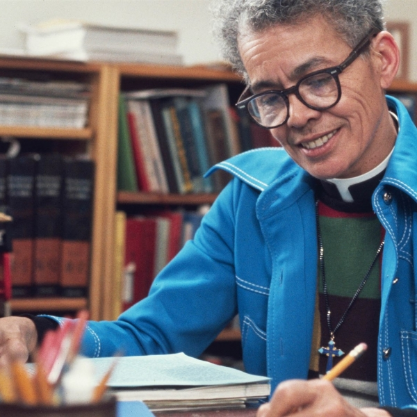 Pauli Murray at a desk - a still from the film