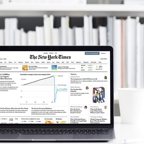 Photo of a laptop displaying the front page of the NY Times